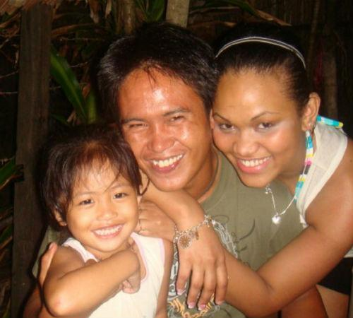 Kristal Abalos, right, with some of her family members. Most of her family members are living in the Philippines -- and they're unaccounted for after the typhoon hit last week.