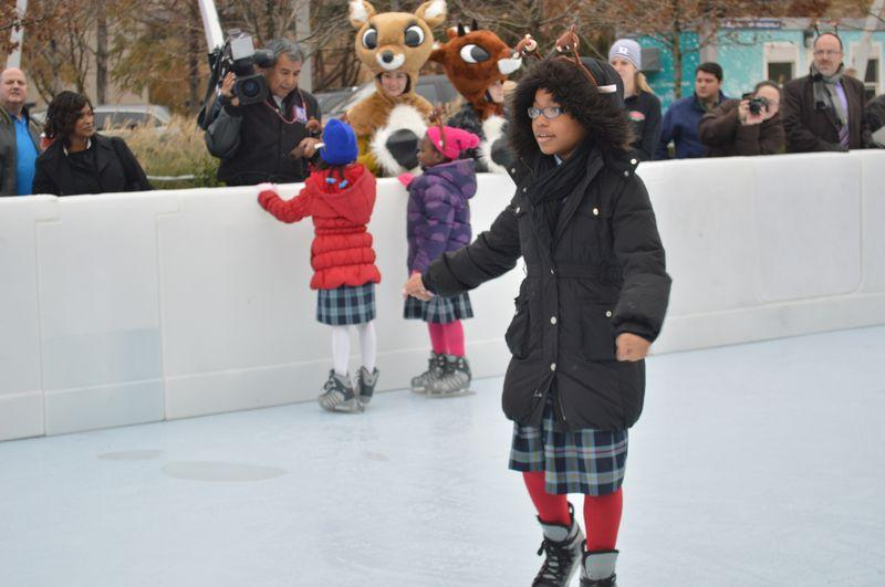 Students participated in the debut of the skating rink midday Friday.