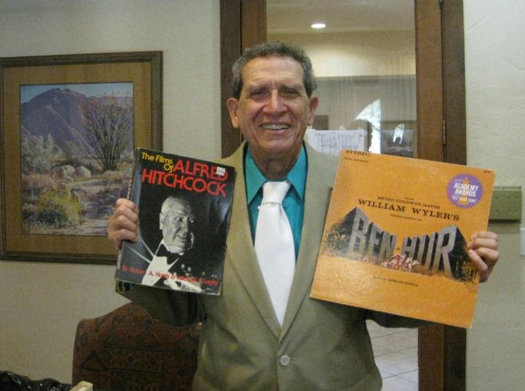 Movie music collector Sal Favia happily showing off some prized items of his sountrack collection.  He figures he's got several thousand recordings in a collection he's been amassing for more than fifty years.