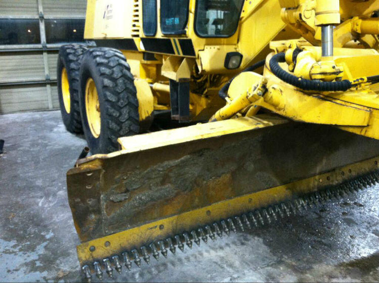 One of the heavy-duty motor graders that will be chewing up the ice on North Texas freeways.