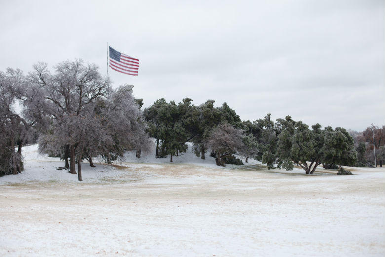 The scene at a sleet-covered Flag Pole Hill in Dallas.