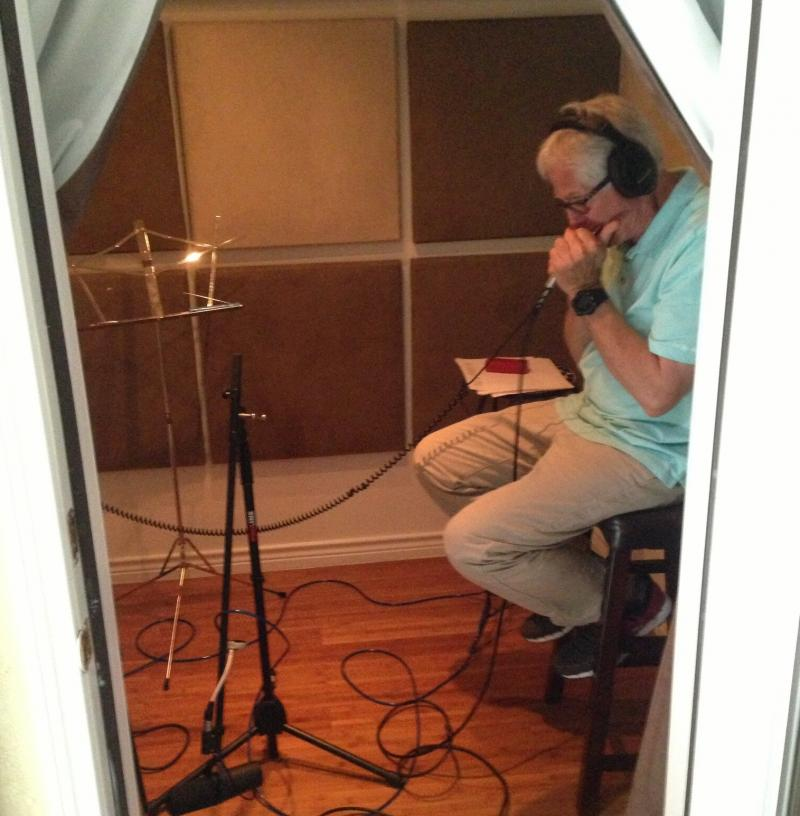 "Paul Harrington lays down a sped-up version of the harmonica line in Lee Oskar's hit ""San Francisco Bay"" at a North Dallas studio. The cut's featured prominently in ""Timber,"" a Pitbull track featuring Ke$ha that's spent 10 weeks on the Billboard charts."