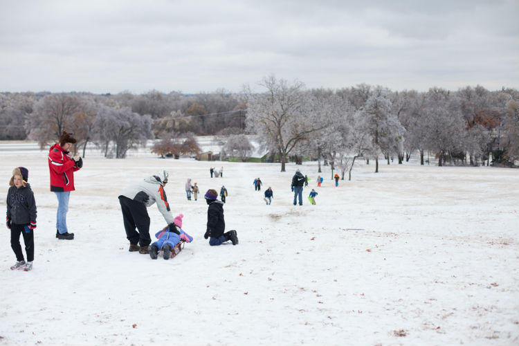 The ice, sleet and snow aren't a problem for kids at Flag Pole Hill in Dallas.