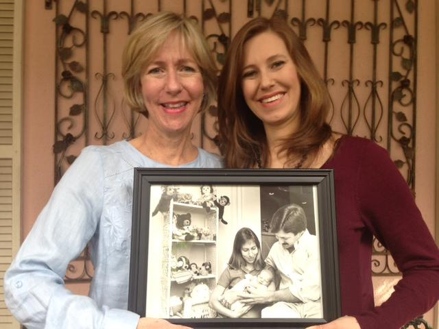 Mary Alice Collins and Courtney Collins pose with the original photo that ran in the Sarasota Herald Tribune with the article that announced Courtney's birth.