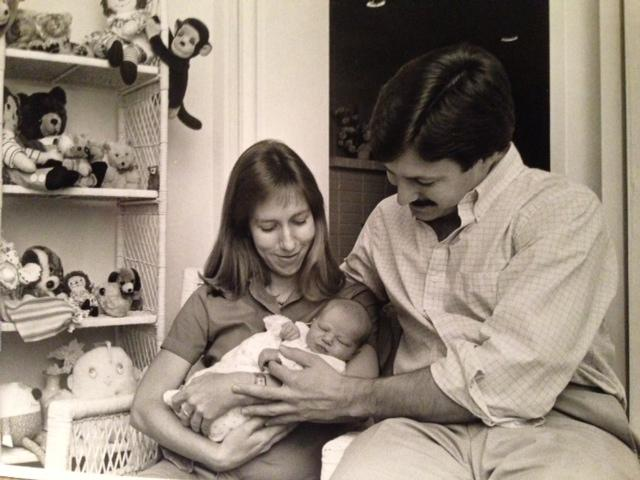 Mary Alice, Lewis and Courtney Collins a few days after Courtney's birth