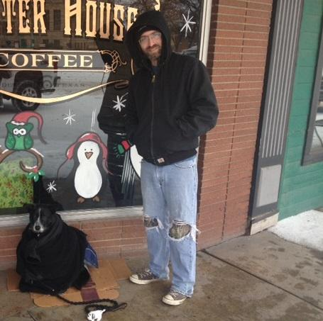 Jon Frayling stands outside Jupiter House with his well-layered dog, Ranger.
