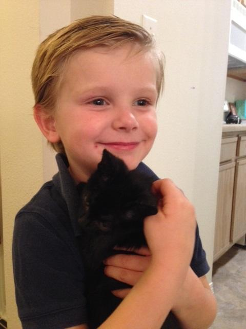 "Sam with his kitten, aptly named ""Little Black Cat."""