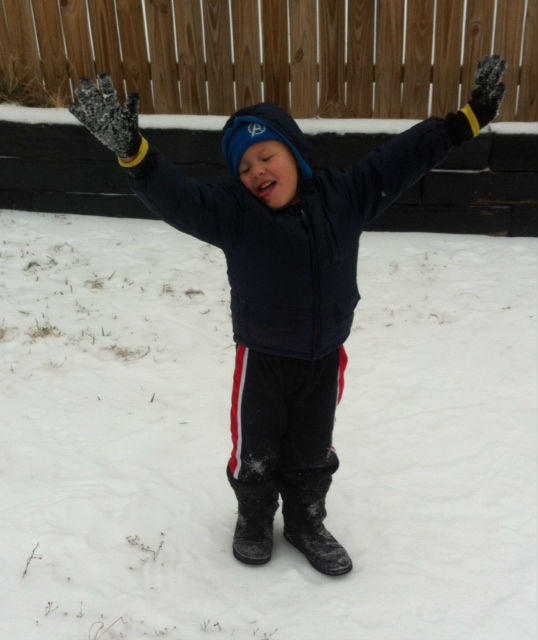 Xander Kisselburg, 5 years old, is enjoying the blast of winter in White Settlement.