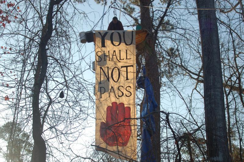 Opponents of the Keystone XL Pipeline held up this banner in 2012.