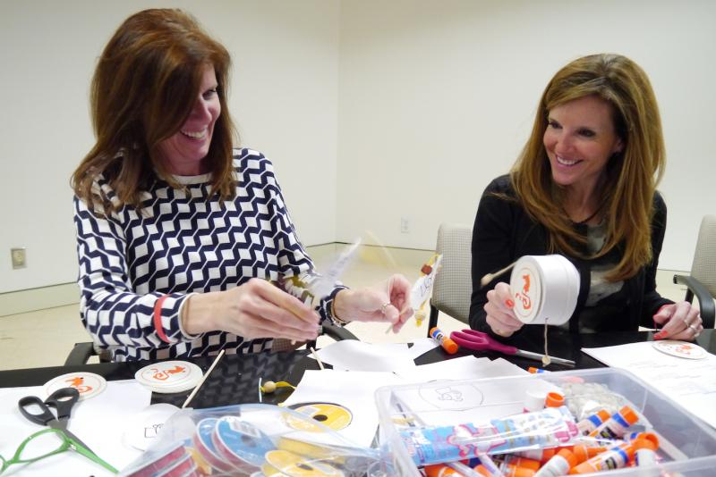 Laura Desjardin and Jill VanGorden make Chinese drum toys for Saturday's Lunar New Year activities at the Crow Collection of Asian Art.