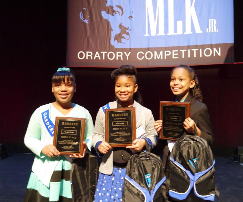 Kayla O'Neal, center, won Friday's Friday's Gardere 2014 MLK Jr. Oratory Competition.
