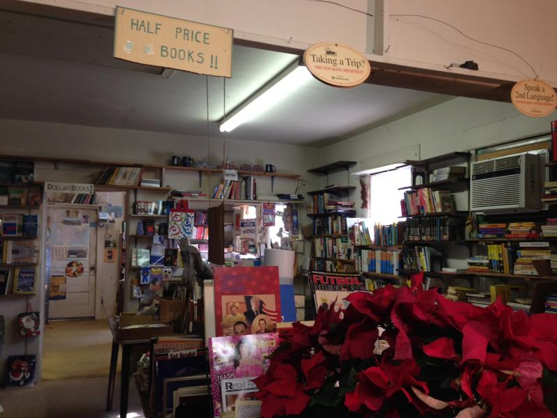 Every wall is covered with shelves at Imported Books in Oak Cliff, including those in Robert Jones' bedroom and kitchen.