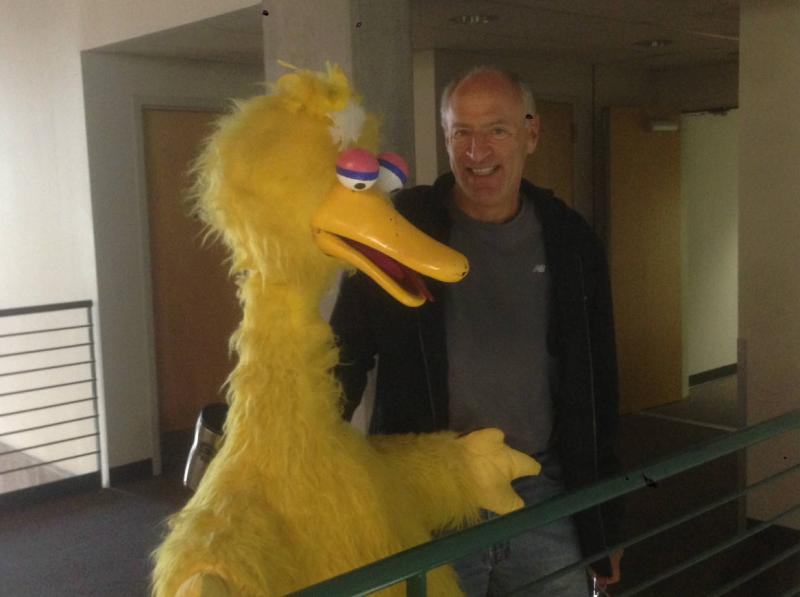 Rangers announcer Eric Nadel pals around with a local during a visit to KERA