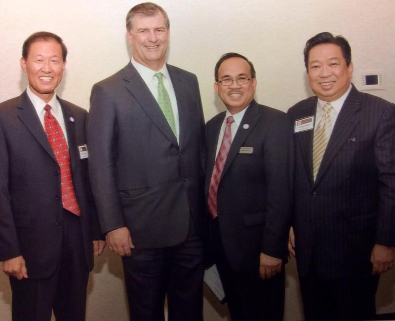 Robert Hsueh, pictured on the right, has died. From left: Michael Lee, Dallas Mayor Mike Rawlings and Galileo Jumaoas.