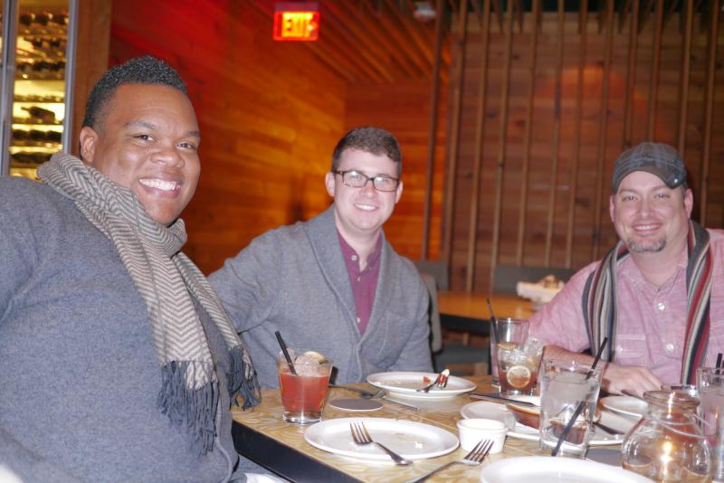 Carl Roberts II, Taylor Rosier and Sean Chambers enjoy food at Fireside Pies. They have a lot of questions about how the Blue Zones project will help Fort Worth.