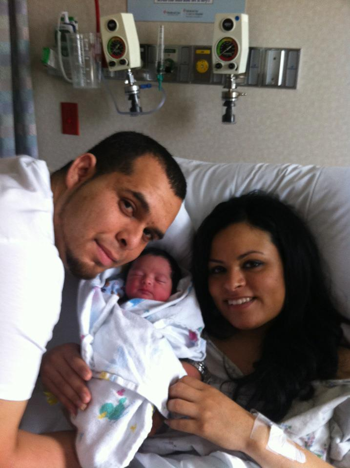 Isac, little Isac and Elizabeth in their first family photo.