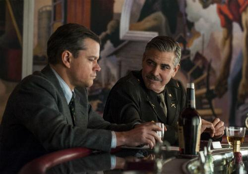 "Matt Damon, left, and George Clooney in ""The Monuments Men,"" based on Dallas author Robert Edsel's book."