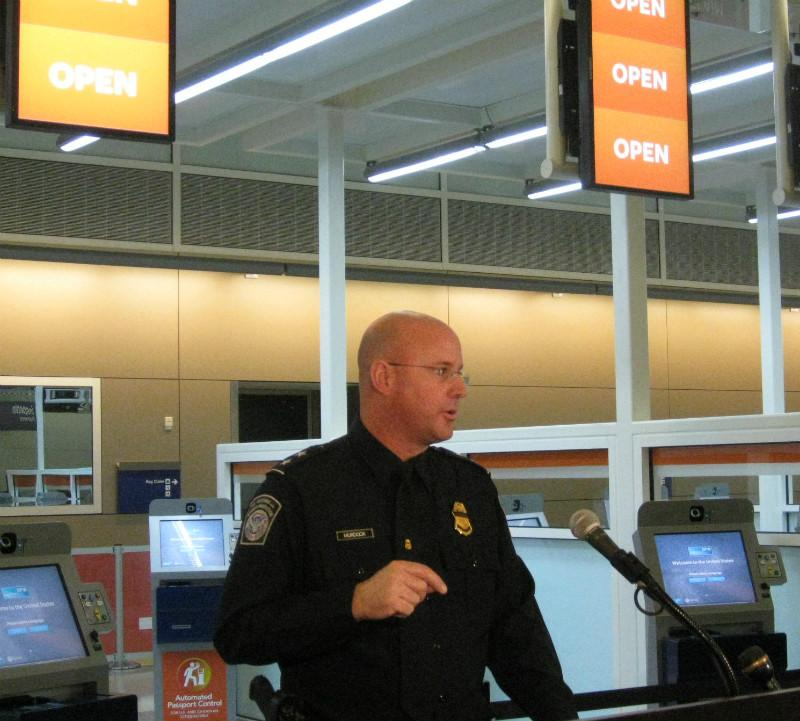 Judson Murdock, U.S. Customs and Border Protection, in front of DFW Airport's automated passport kiosks he calls game changers
