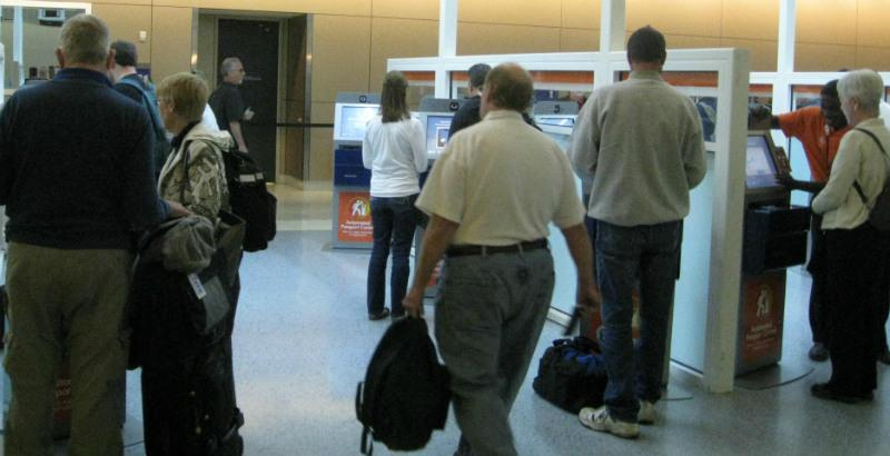 Some of DFW Airport's returning international passengers preferring the automated kiosks officials say are time and money savers