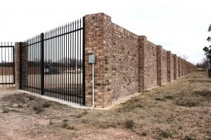 Gated gas: brick wall surrounds well site near neighborhoods on Fort Worth's east side