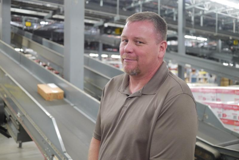 "Robert Roest is a Staples employee in Coppell. He says the green technology that his company has upgraded to has made his daily work easier, ""less headaches."""