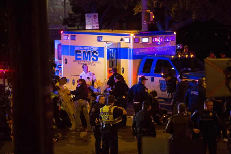 Photographer Andi Harman peered over the Mohawk balcony and found paramedics responding to a crash that left 2 dead and 23 more injured.
