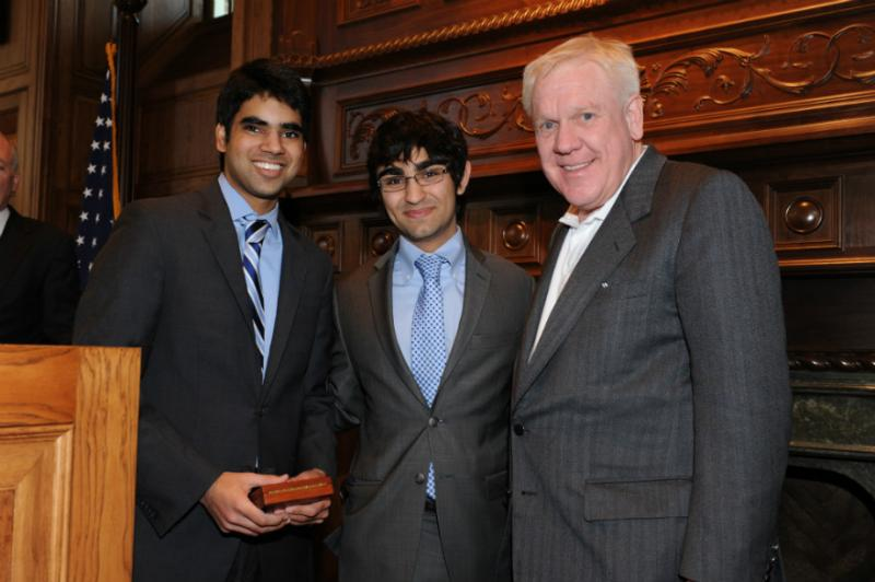 Harlan Crow with last year's debate winners from Dallas' Parish Episcopal School. Students are Sahil Vanjani and Cyrus Ghaznavi.