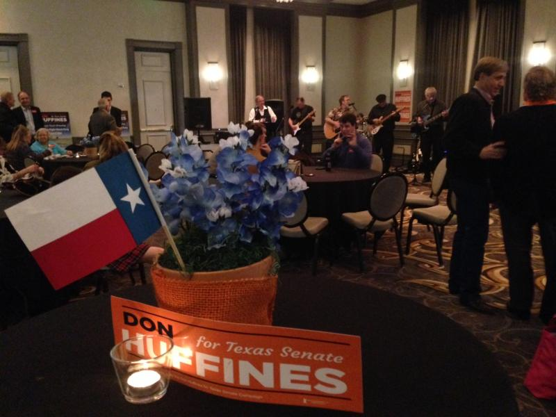 At Don Huffines' watch party, supporters mingled while a band performed.