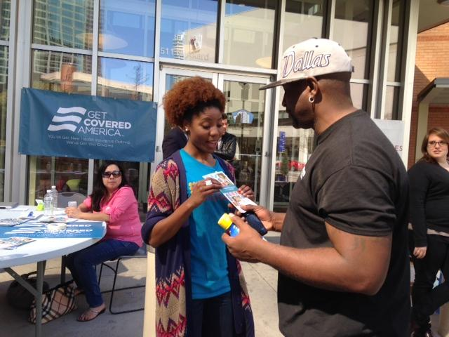 Keilah Jacques of the non-profit CitySquare explains to an East Dallas resident how to get insured under the Affordable Care Act.