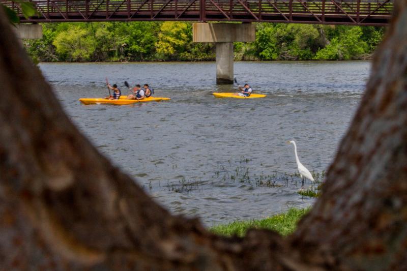 Visitors enjoy White Rock Lake via canoe.