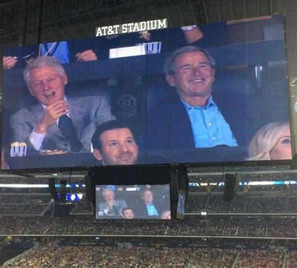 Caught on camera: Former Presidents Bill Clinton and George W. Bush, together in Jerry Jones' suite, a row behind Cowboys quarterback Tony Romo.