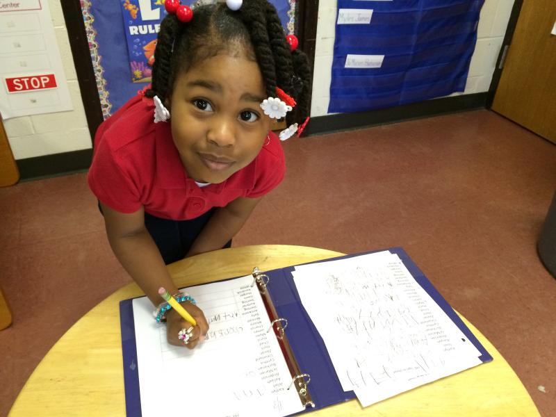 Cherish Moore, who's 4, is learning to write her name in a Dallas pre-kindergarten class.