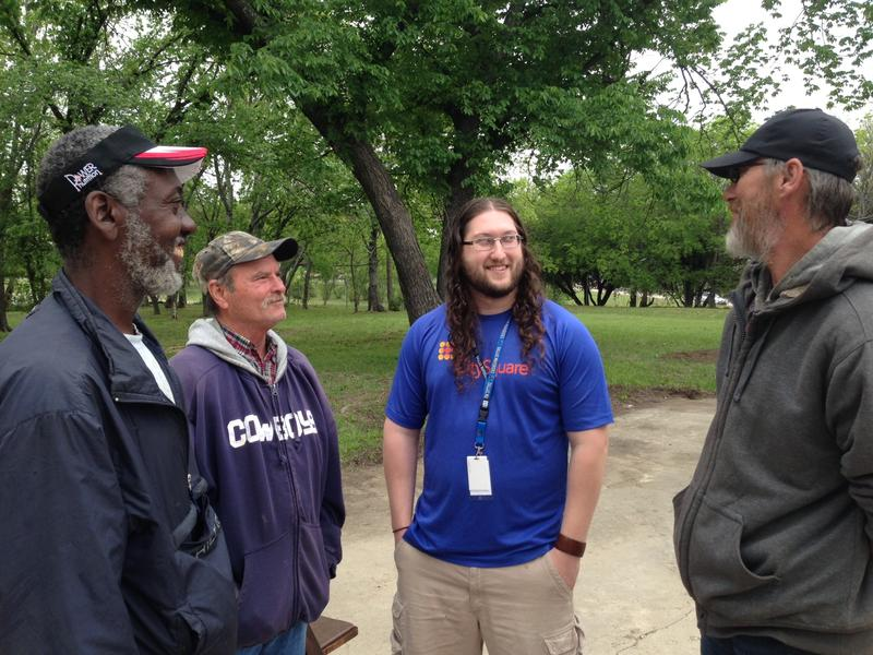 Jonathan Grace (center) works with CitySquare helping homeless residents like Tony Drone (left), John Rhodes and Jerry Day (far right).