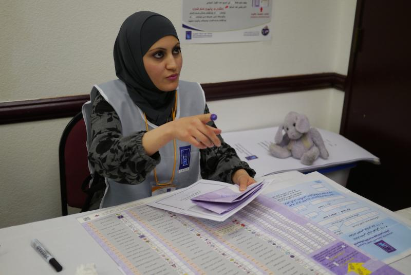 An election worker at an Iraqi election center in Dallas.