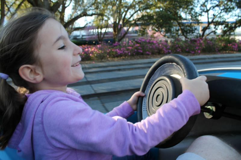 My daughter, Claire, gets her first driver's ed lesson -- the Speedway at Magic Kingdom.