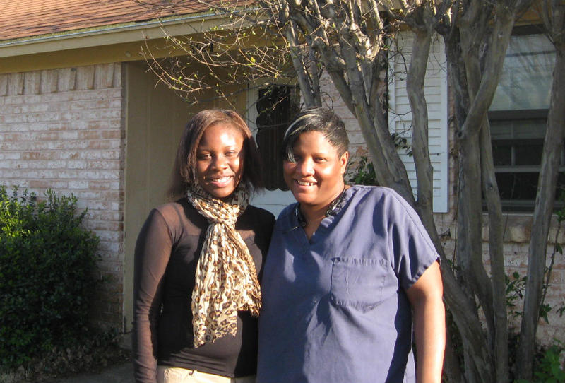 Kelli and her mom Gloria Mason standing in front of the house where they both live. Mom and dad are divorced and Kelli's father lives nearyby
