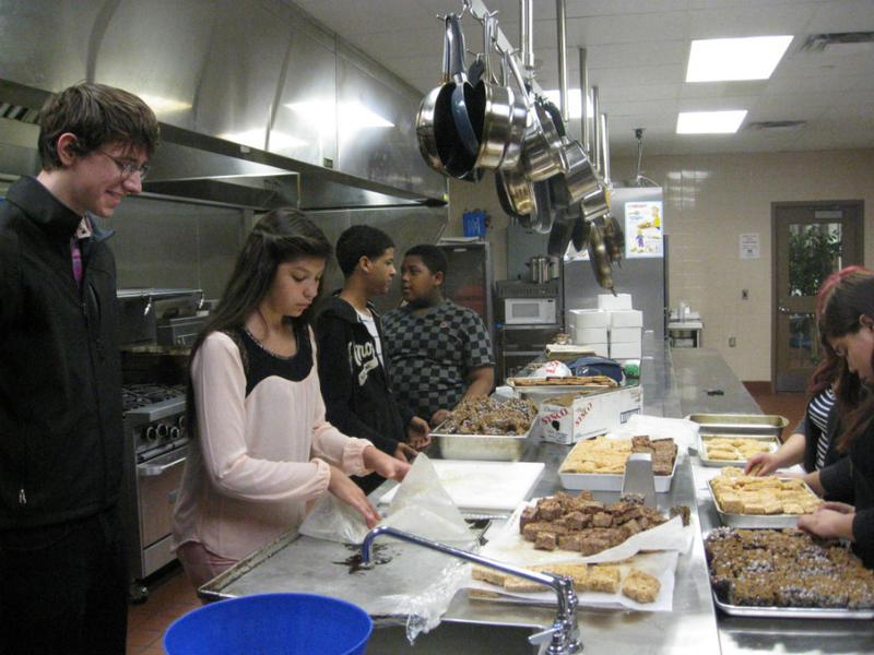 Culinary students in Wilmer-Hutchins High School kitchen on bake sale day.