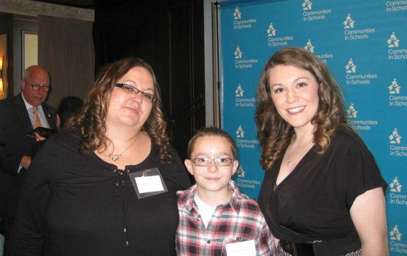 From left: Cansas Surrett, her son Theron Bowman, and CIS social worker Kaitlin Tollison. Combined efforts helped the 12-year-old turn a troubling physical ailment and school problems into a healthier environment for living and learning.