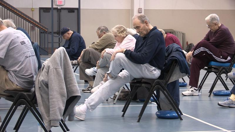 Older people participate in a fall prevention class at the University of Texas at Arlington.