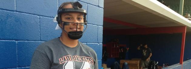 Kylee Fowler plays third base - and she's alright with wearing a facemask.