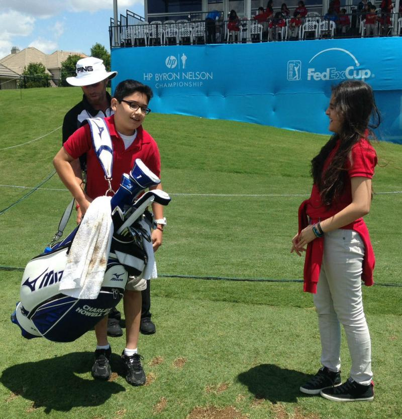 Carlos Diaz, 11, took his turn in carrying a golf bag at the Byron Nelson tournament.