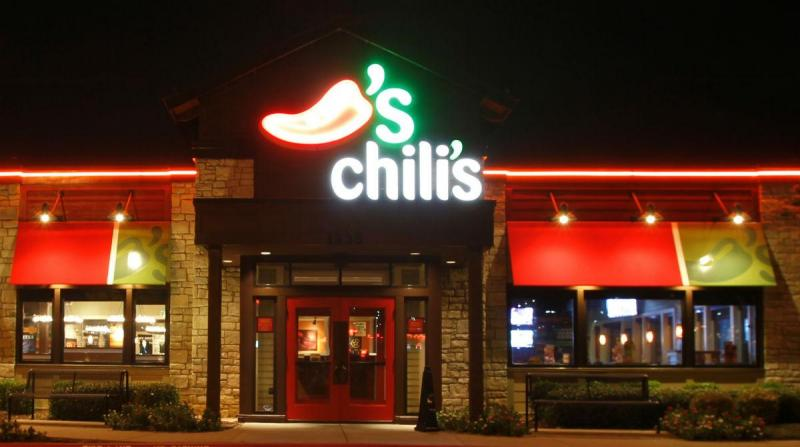 The Dallas-based parent company of Chili's says it's reviewing its policy on guns in its restaurants after men brought in rifles to a San Antonio restaurant.