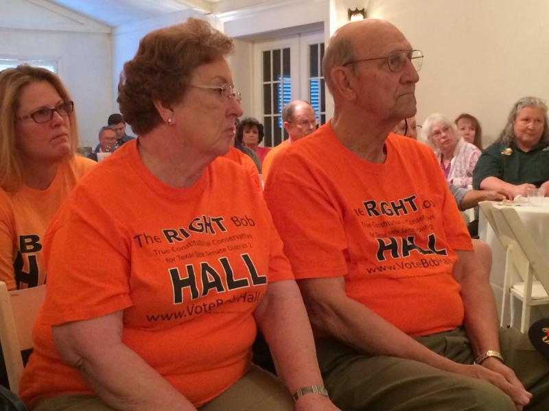 "A couple wearing shirts in support of a Tea Party challenger attended the ""Life, Liberty and Property"" rally in Greenville last week."