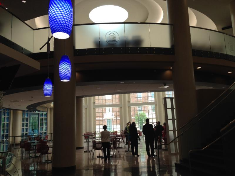 The new dining hall includes numerous projection screens and food options, including gluten-free and juicing stations.