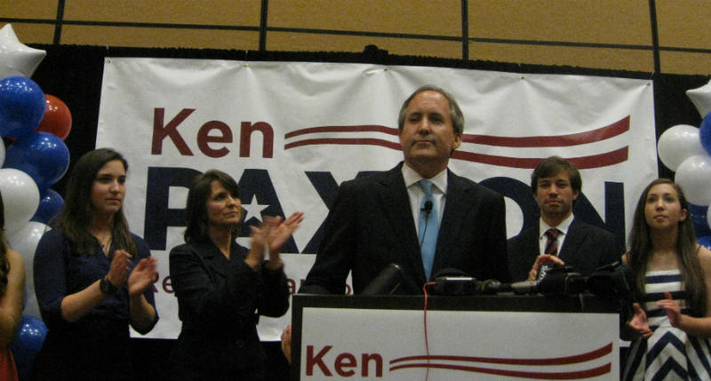 State Sen. Ken Paxton, with his family, declared victory Tuesday night in the GOP runoff for Texas attorney general. Paxton defeated State Rep. Dan Branch.