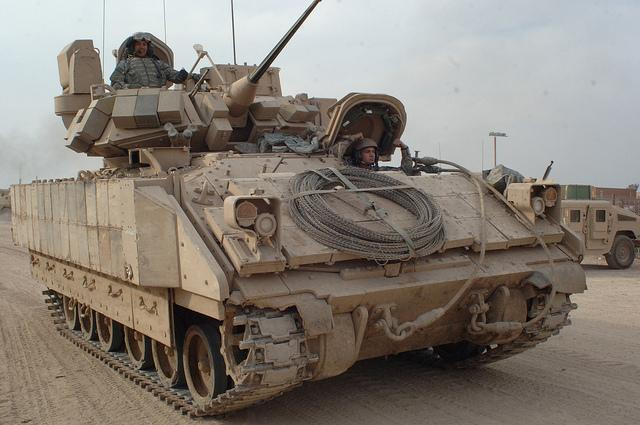 U.S. Army Soldiers drive a Bradley fighting vehicle in Iraq in 2007