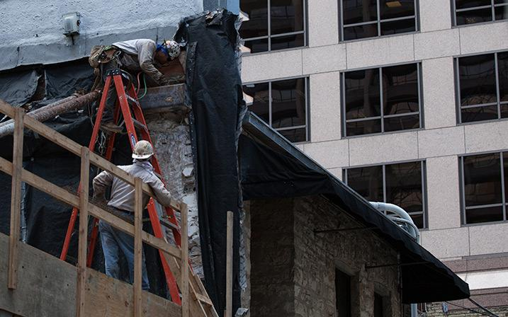 Workers help with construction of a building in Austin. Photo by Todd Wiseman.