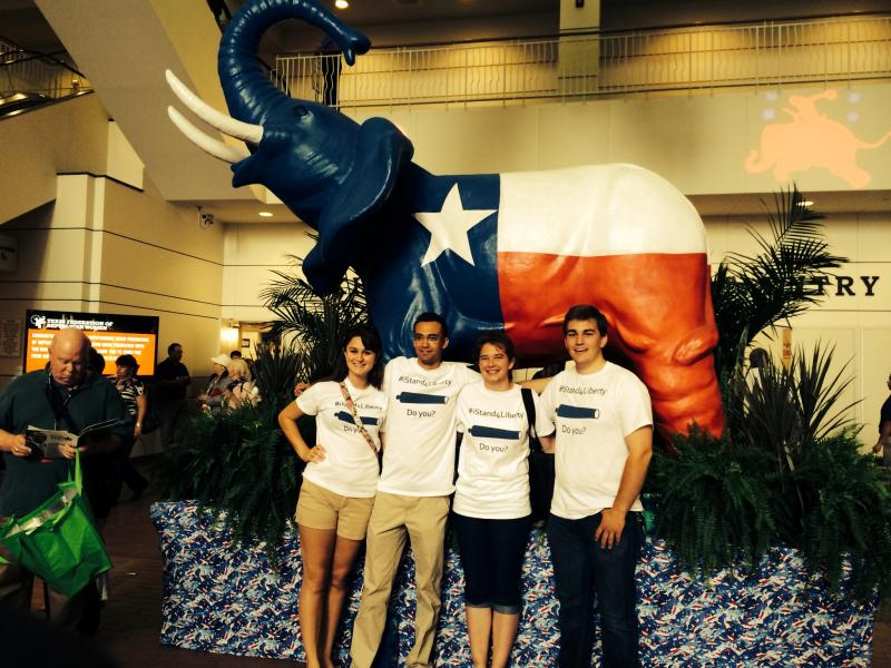 Attendees gathered in front of a Texas-themed elephant.