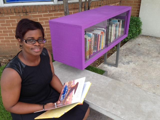Jamonica Washington checks out a children's book at the Lakewest YMCA's Little Free Library.