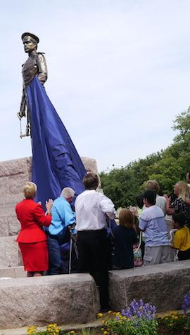 Fort Worth Mayor Betsy Price helps to unveil a new statue on Panther Island, honoring the founder of the city, US Army Brevet Maj. Ripley Allen Arnold.